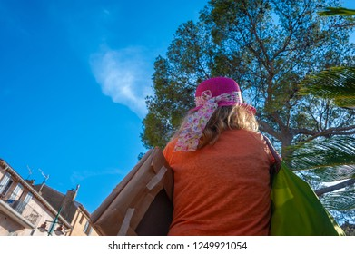 Woman in the streets of Saint-Tropez in the Department Var of the province Provence-Alpes-Cote d Azur