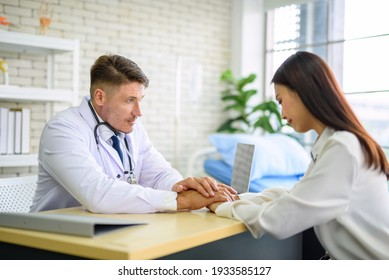 The woman is stressed with anxiety symptoms and the psychiatrist shows the patient's sympathy on the background of the clinic.