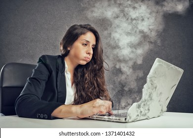 Woman stressed by overwork with the laptop melting