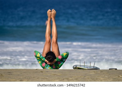 woman with stretched legs, training, yoga, facing the sea