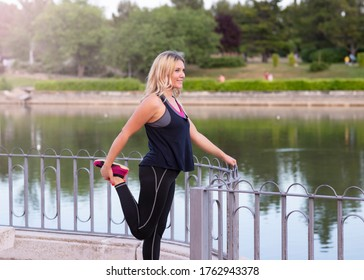 woman stretches her legs after exercising outdoors