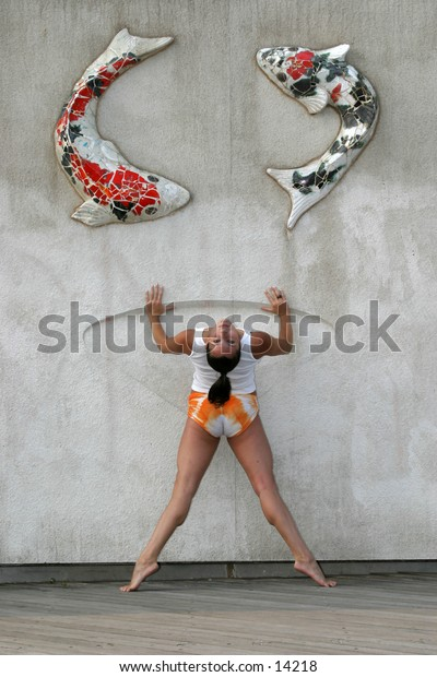 woman stretching against wall