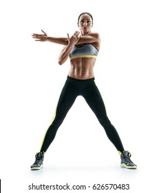 Woman stretching arms before exercise. Strong woman with perfect body on white background. Strength and motivation
