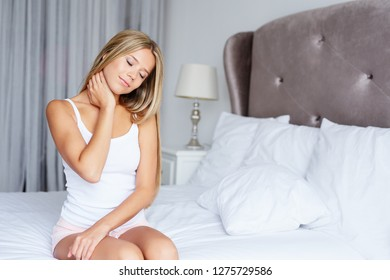A woman is stretching a cervical spine in her bed
