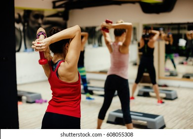 Woman Stretching group. women fitness class indoors.