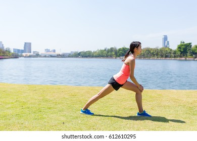 Woman stretching legs before running