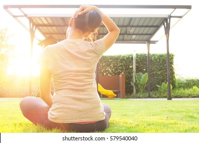 Woman stretching the neck muscles with yoga posture with neck pain.Having painful neck  and stretching muscles fatigue To relieve pain. health concepts.