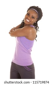a woman stretching out her arm with a smile on her face