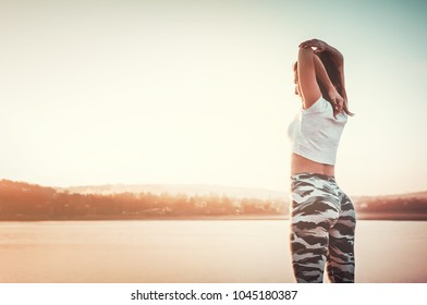 Woman stretching outdoors after jogging training