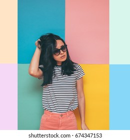 woman in striped shirt and pink skirt on a colorful background