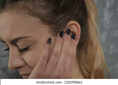 woman is struggling with earache, side view