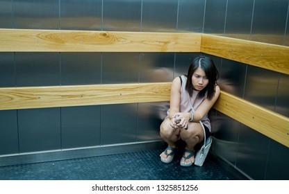 woman stuck in the elevator, girl very sad