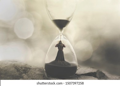 woman stuck in an hourglass, concept of being prisoners of time passing