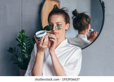 Woman studies the instructions for using eye patches. - Shutterstock ID 1953936637