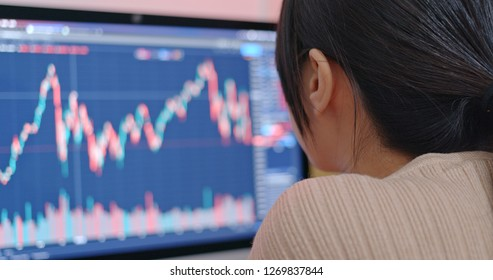 Woman study the stock market data