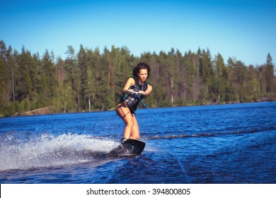 Woman study wakeboarding on a lake