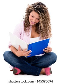 Woman studying and reading her notebook - isolated over a white background