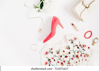 Woman styled fashion clothes and accessories collage on white background. Flat lay, top view feminine background.
