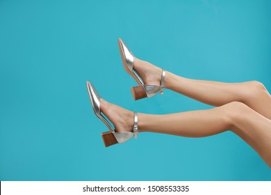 Woman in stylish shoes on light blue background