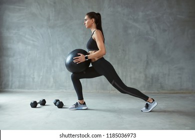 Woman In Stylish Sports Wear Training With Med Ball