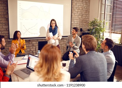 Woman successfully finished presentation on seminar with applause
