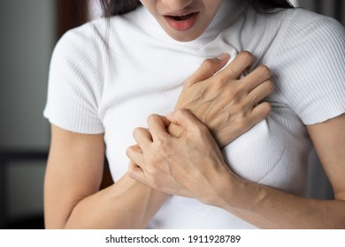 woman with sudden heart attack, sick woman suffering from acute heart attack, concept of emergency health care, asian young adult woman model