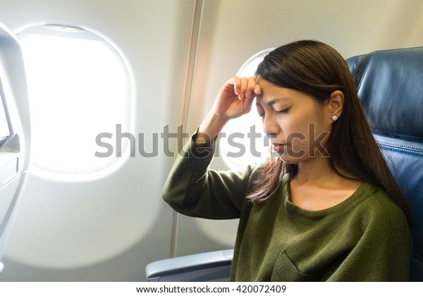 Woman suffer from headache inside airplane