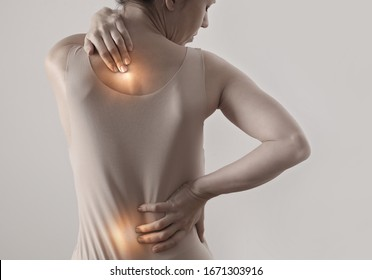 Woman suffering from back pain. Chiropractic, Physiotherapy concept