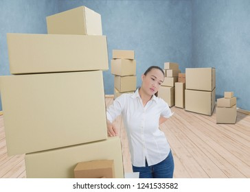 woman suffering from backache while moving boxes. heath care and medicine concept