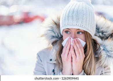 Woman suffering a cold winter outdoors with a snowy mountain in the  background. Illness in 4f3237e08643