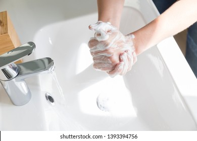 A woman suffering from contamination OCD: obsessive hand washing.