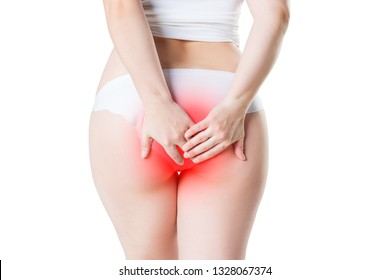 Woman suffering from hemorrhoids, anal pain isolated on white background, painful area highlighted in red