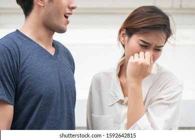 woman suffering from man bad breath, concept of tooth decay, gingivitis, poor oral hygiene, bad breath or ordor smell from unhealthy mouth, poor personality, oral hygiene health care