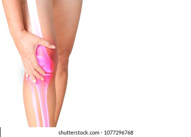 Woman suffering from pain in knee holding and massaging her painful knee double exposure with x ray film of inflammation knee joint. Health care and medical concept.