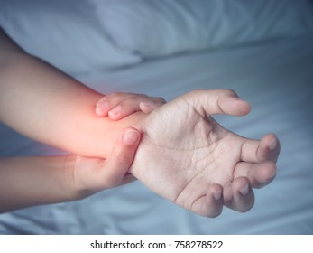 Woman Suffering From Painful Feeling In Arm Muscles at Home. Health Care and Medical Concept.