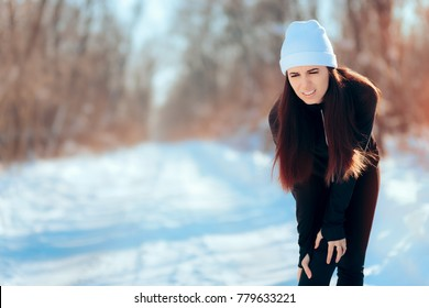 Woman Suffering Running Injury Leg Accident in Winter Training Session. Hurt girl in pain for exercising without stretching