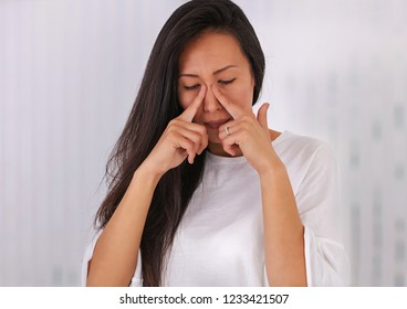 Woman suffering from sinusitis or Allergic rhinitis
