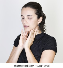 Woman suffering from throat problems