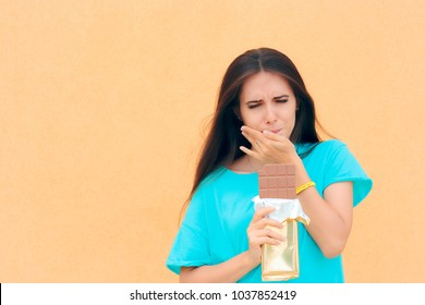 Woman Suffering Toothache After Eating Chocolate. Girl feeling tooth pain from dental problems related to sugar consumption