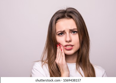 woman suffering from toothache, tooth decay or sensitivity