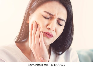 Woman suffering from toothache, tooth decay or sensitivity.