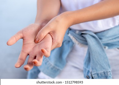woman suffering from trigger finger, cps or carpal tunnel syndrome, gout desease, arthritis inflammation, hand pain; health care or body care concept; asian 20s young adult woman model