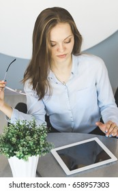 Woman in suit with tablet pc,overhead mock up.Office worker,student