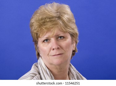 woman with a sullen look on her face