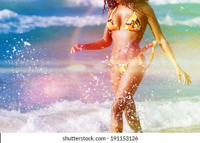 Woman in summer beach vacation walking in sun looking over the ocean