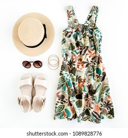 Woman summer clothes travel, collage on white background. Sundress-dress, straw hat, sunglasses. Top view, flat lay.