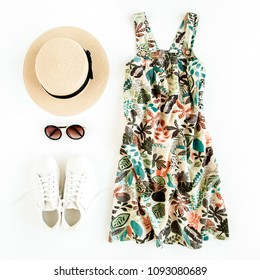 Woman summer clothes travel, collage on white background. Sundress-dress, straw hat, sneakers, sunglasses. Top view, flat lay.