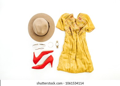 Woman summer colorful fashion clothes and accessory set on white background. Flat lay, top view.