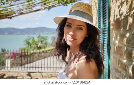 woman in summer dress walking and running joyful and cheerful smiling in Tuscany, Italy.