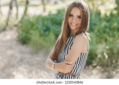 woman summer portrait. shining smiling girl outdoors. fashion and beauty